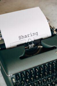 A typewriter writing sharing symbolising sharing information