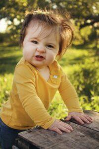 A curious toddler playing the garden