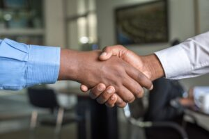 A handshake representing Improved employability through digital learning