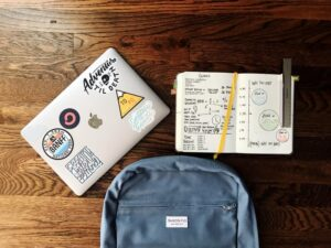 A school child's backpack, laptop and notepad