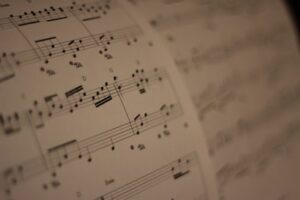 Reading sheet music for both Guitar and Piano