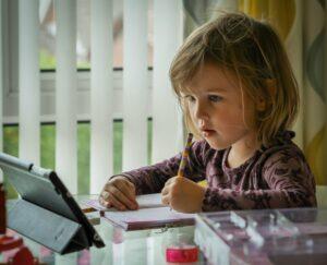 A child learning through an app on an iPad