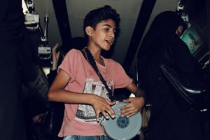 A child learning musical theory through play
