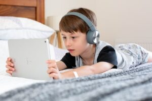 A child using an iPad for digital learning from home