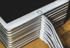 A stack of charging iPads