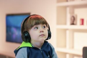 A kid listening to his favourite music for homework