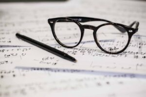 A pair of glasses resting on sheet music