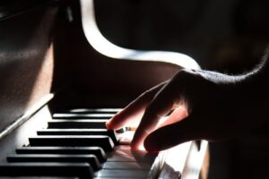 A close up of a person playing the piano