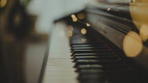Light specs reflecting above piano keys